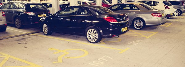 Cars parked in disabled parking spaces within Car Park 1