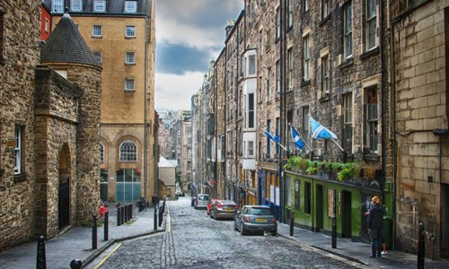 Cars parked on cobbled streets in Edinburgh