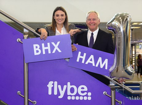 Amy Ward Operations  Sales Manager at Savage Marine and Paul Willoughby Regional Sales Manager for Flybe celebrate the airline's first annivers.jpg