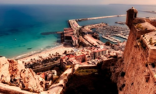 Port town Alicante in Spain overlooks the stunning blue Mediterranean Sea.