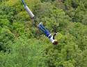 Someone flying through the air mid bungee jump in New Zealand