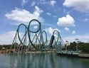 Huge green roller coaster set over water in Orlando