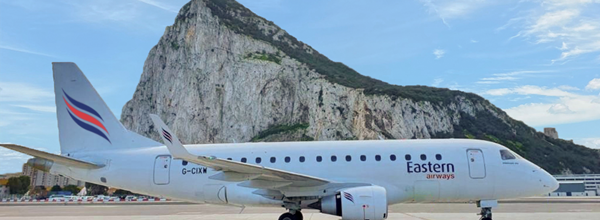 Eastern airways aircraft in front of Gibraltar rock